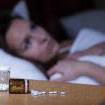 Sleeping Pills Lying On Night Table.jpg