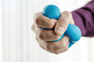 Businessman holding Anti-stress balls in