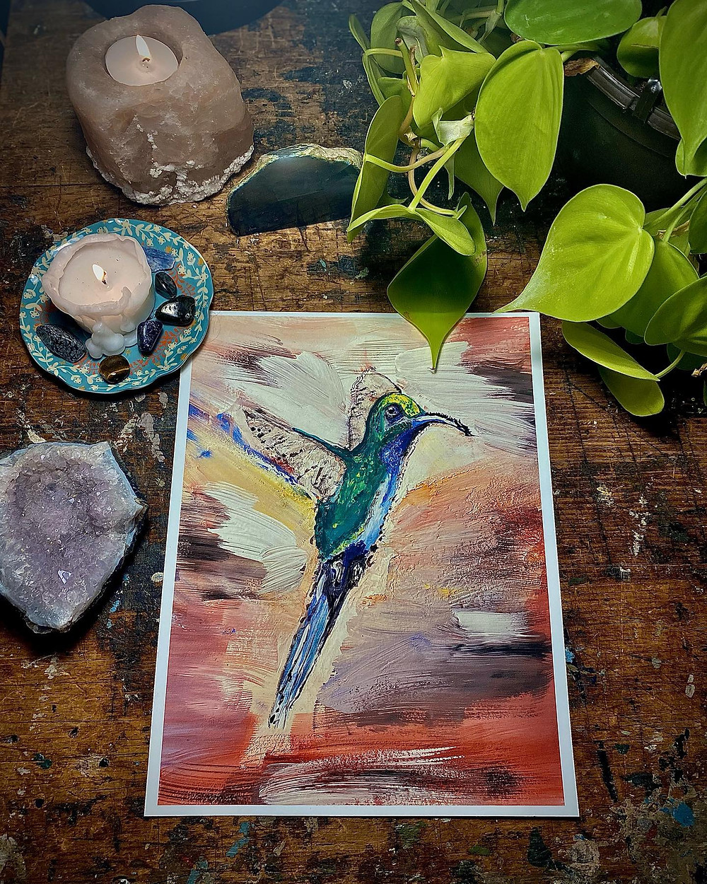 Humming Bird Acrylic Painting Surrounded By Candles and Plants