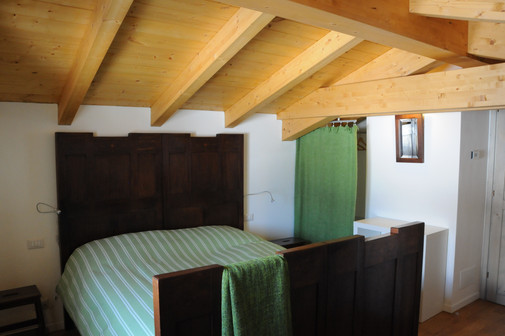 one of the 2 bedrooms on the upper floor