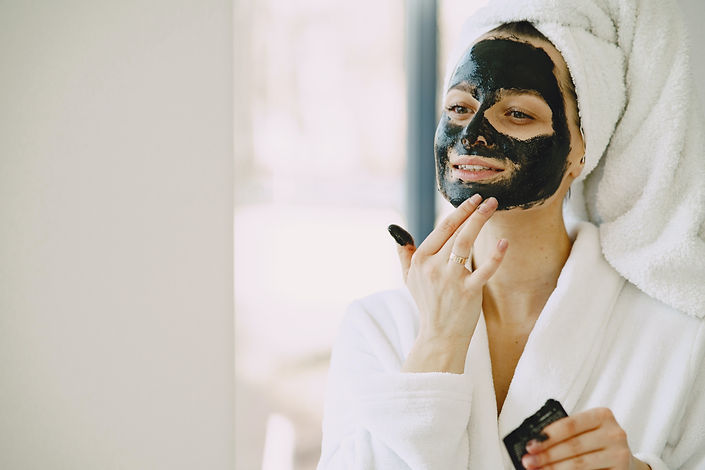 photo-of-woman-applying-clay-mask-on-her