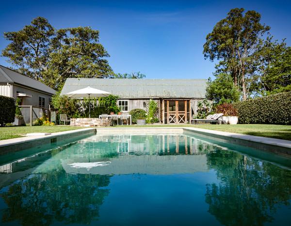 Swimming pool garden enclosure