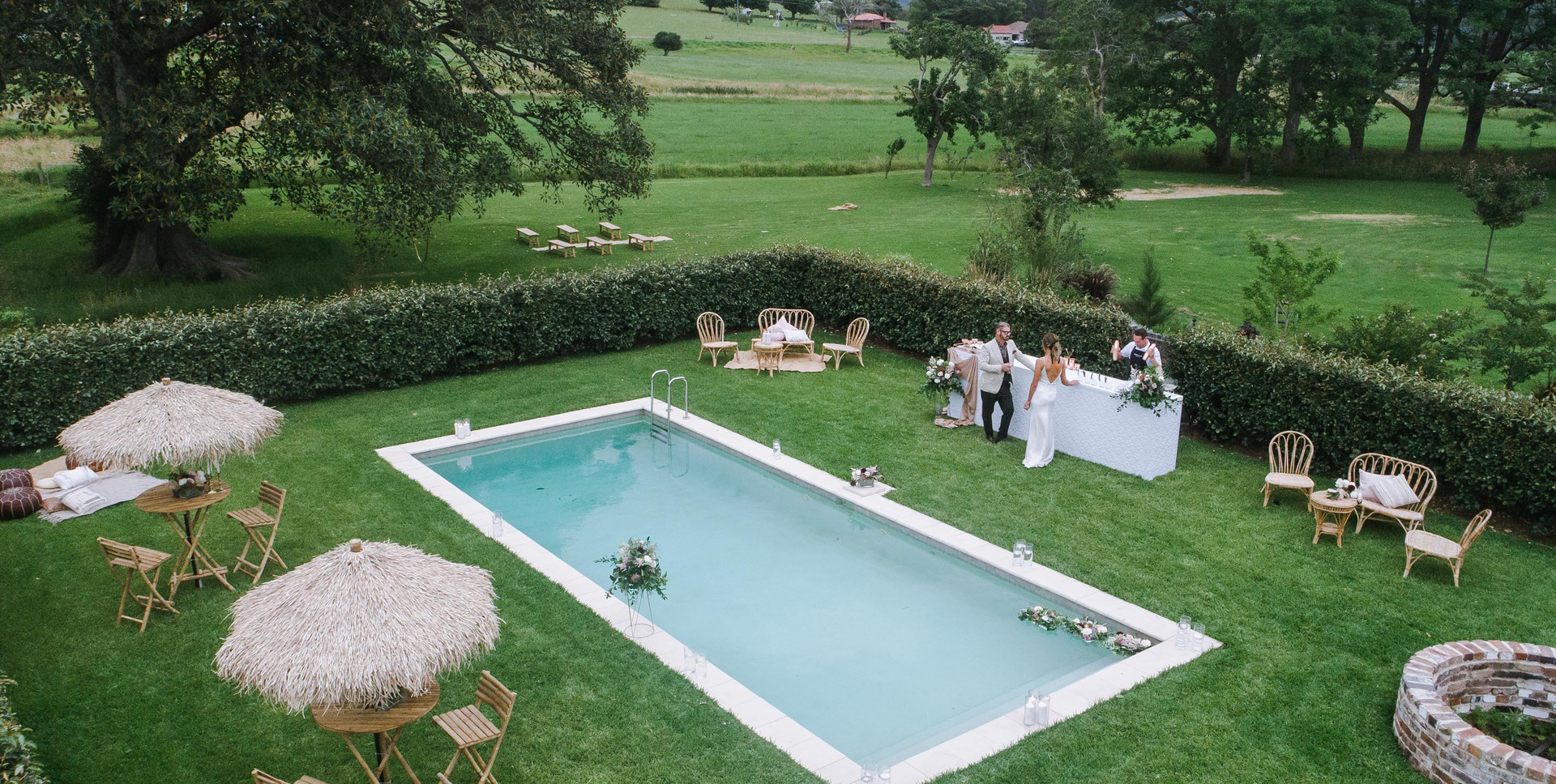 An informal yet elegant poolside set-up by The Wedding and Event Creators