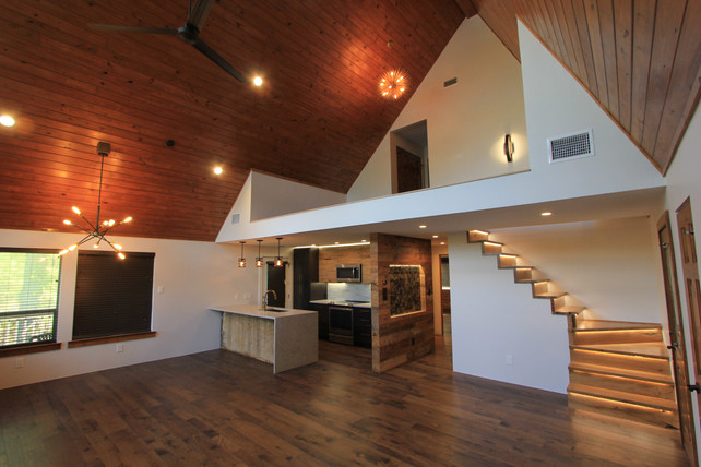 Wide angle view of the the living, kitchen, and loft.