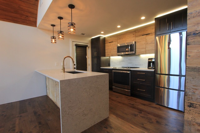 Kitche final with rustic pendent lights and two tone wood cabinets