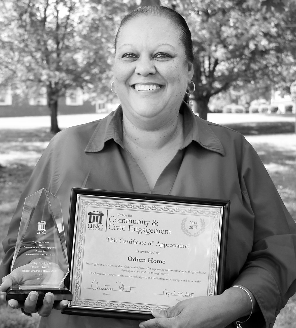 "Kathy Locklear, Odum Home's residential campus manager, accepted the University of North Carolina at Pembroke's (UNCP) ""Community Partner of the Year Award"" on behalf of BCH at a recent awards luncheon."