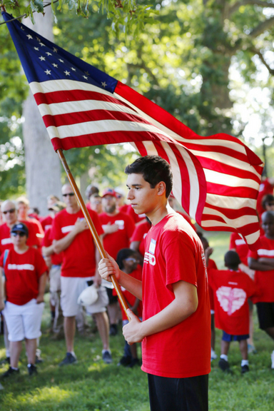 BCH resident Cruz holds the flag during the Pledge of Allegiance.