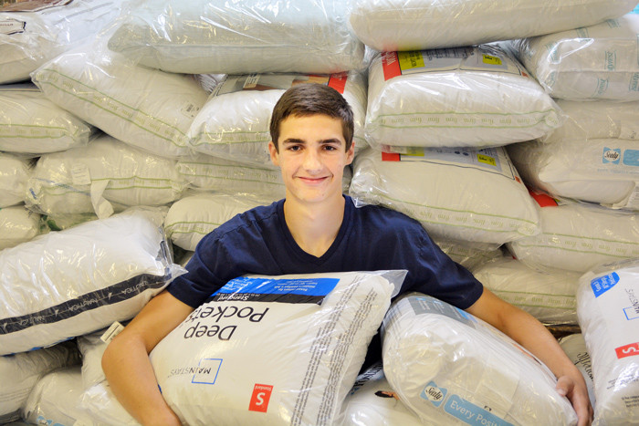 Sixteen-year-old John Shuster's pillow collection campaign provided 89 new, standard pillows for the residents at Kennedy Home in Kinston.