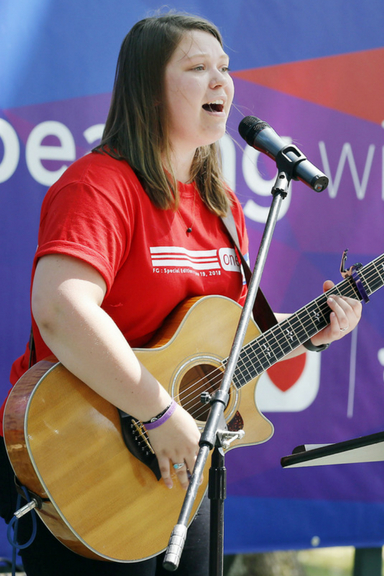 Julianna Johnson, daughter of Broyhill Home cottage parent Tim Johnson, performs on the outdoor stage.