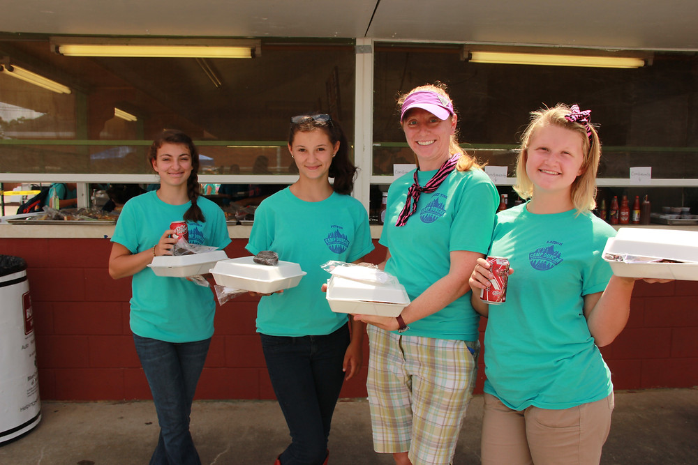 Girls from Camp Duncan and Chief Tina took time out for a barbecue lunch that was provided for a donation.