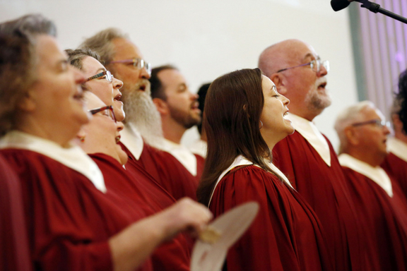 """The """"Heartbeats,"""" a choir of BCH staff members from every ministry and from around the state, perform during the worship service."""