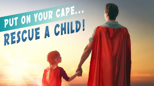 Child and adult with superhero capes
