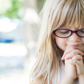 Children pray for those impacted by Hurricane Florence