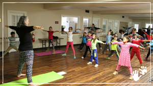 Weekday Education children exercise and meditate with Christ