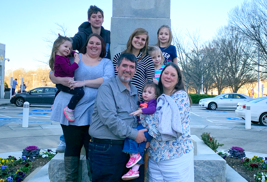 The Clines, the sisters, and BCH's Krystal Saunders and Rae Francis stand outside the Gaston County courthouse after adoption papers were signed.