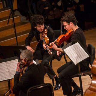 Playing the Trout Quintet by Franz Schubert with pianist Daniel Gortler, violinist Itamar Zorman, cellist Raz Kohn and bassist Noami Shaham at the 2019 Israeli Schubertiade. On stage at the Tel Aviv music academy, Stricker.