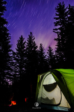 shooting star trails into the night
