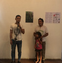Artist Jhonathan Curi Doñez and family presenting