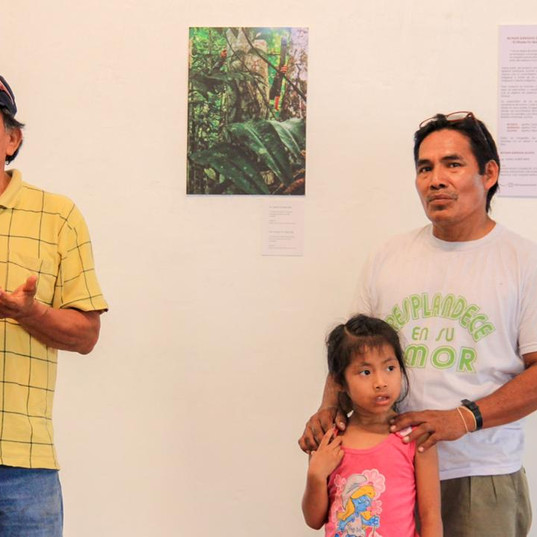 Farmer Juan presenting about the importance of planting and participatin in photographic exhibition