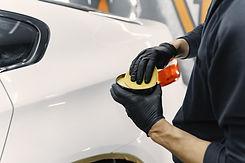 man-polish-car-garage-2.jpg