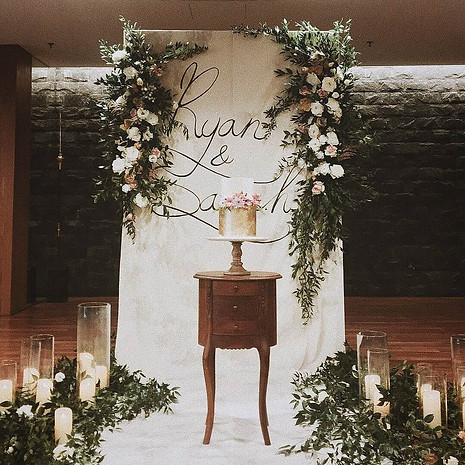 Dip dye vintage backdrop for Ryan and Sarah, decked with flowy floral arrangement