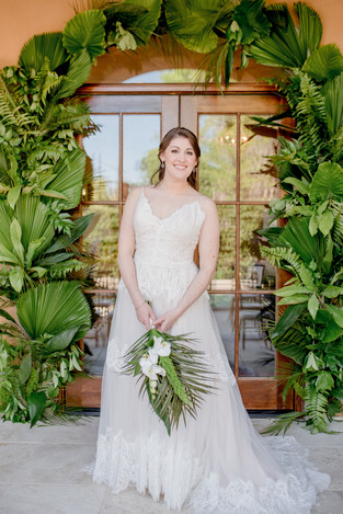 savannah wedding tropical leaves ceremony arch