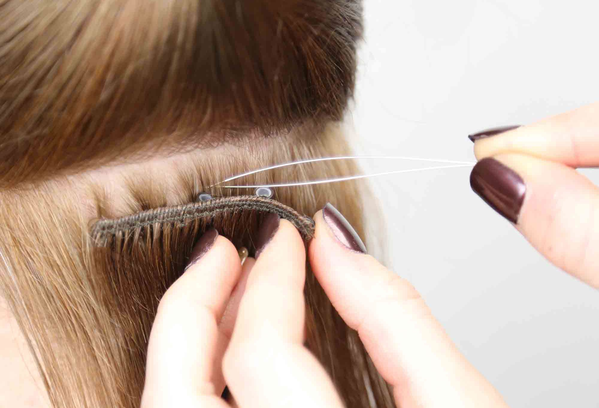 Beaded weft hair extensions