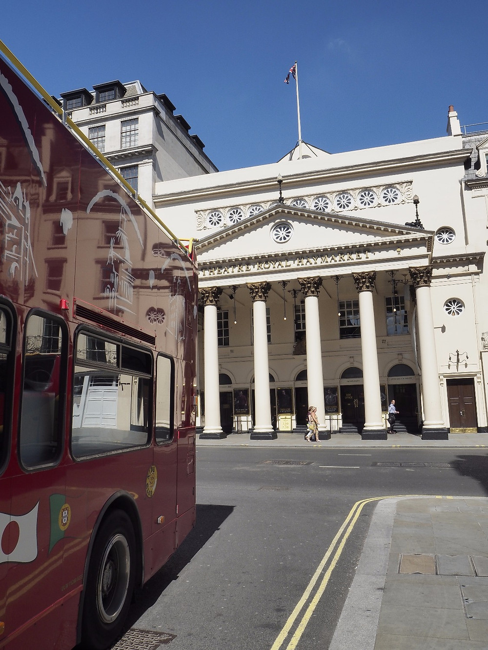 Theatre Royal Haymarket and a Tour Bus