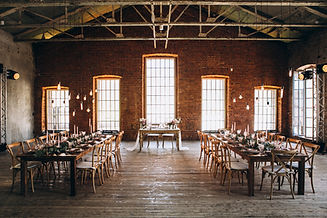 Brick tile cladding in large venue used as a wedding hall