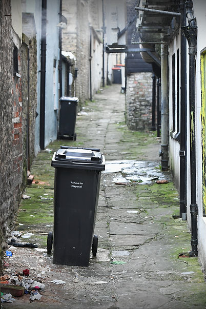 View of an Old Rubbish Strewn Back Stree