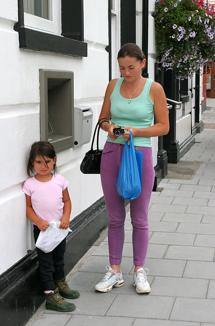 Woman holding a purse with a little girl