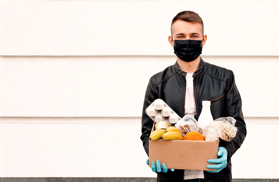 Courier%20man%20in%20face%20mask%20with%20food%20box%20in%20his%20gloved%20hands%20outside.%20Corona