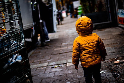 Child facing bleak london street.jpg