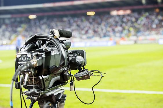 TV camera at the stadium during football