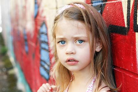 Worried little girl in an urban setting