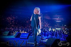 gyze aruta stage bassist