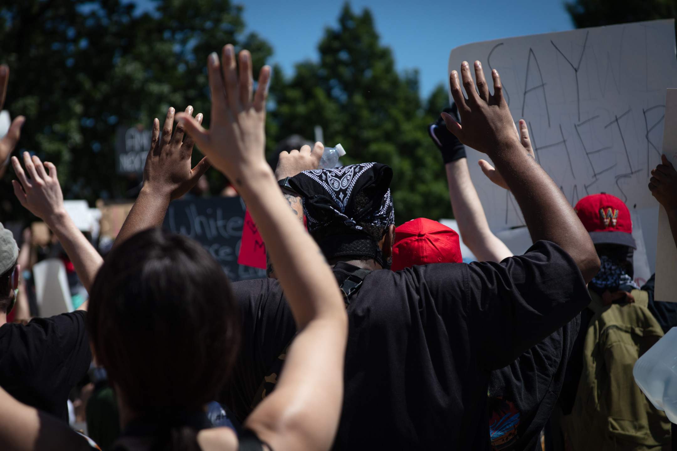 Protesters hold their hands up to symbolize the unarmed black Americans murdered by police, in some cases with their hands up to show they were unarmed. Outside of the United States Capitol in Washington, D.C., May 30, 2020.