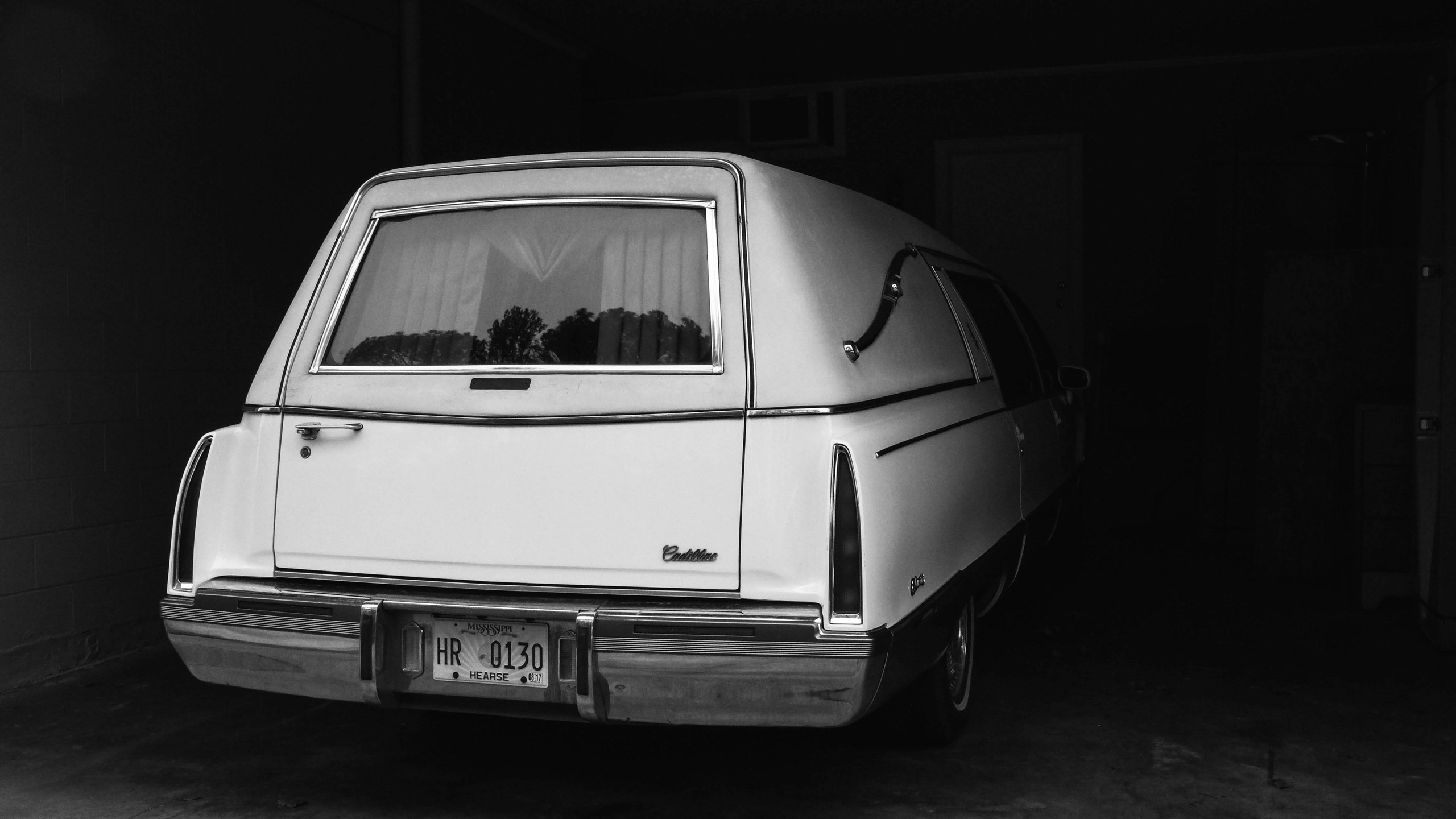 Jordan Funeral Home's hearse in the garage.