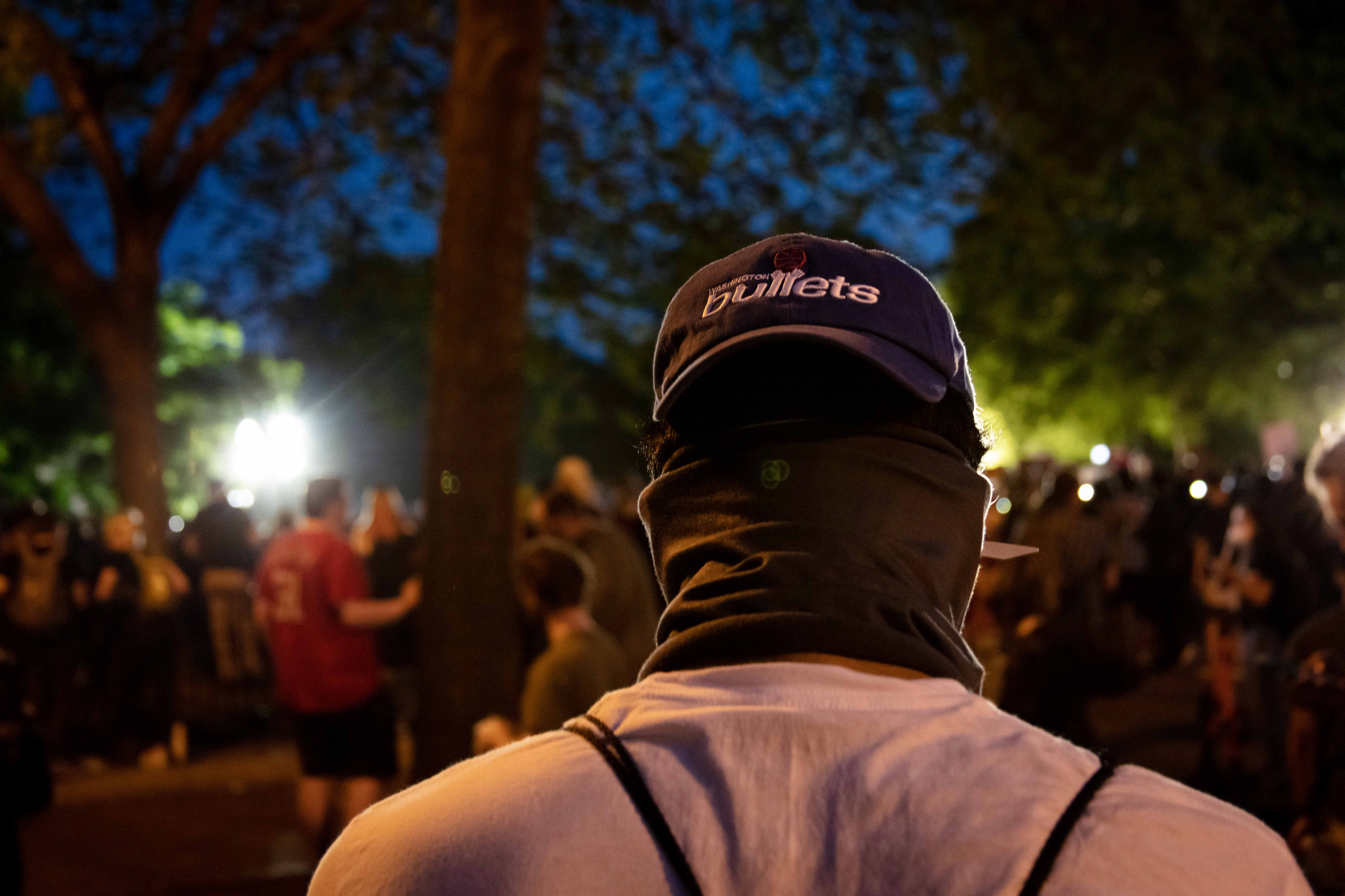 A protester outside the White House wears a Washington Bullets hat. The Bullets were D.C.'s basketball team before the name was deemed too violent.
