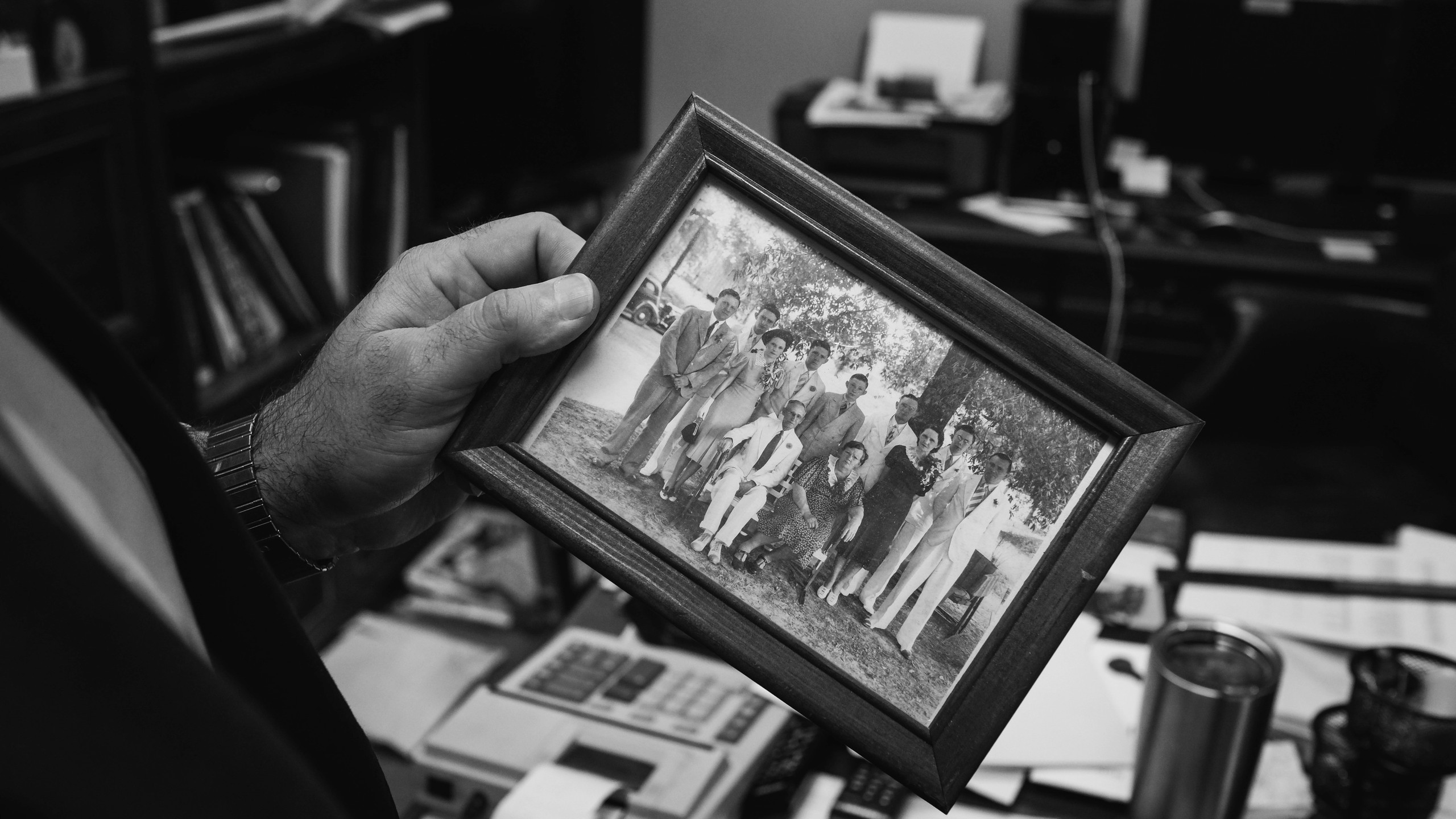 Hunter Jordan holds a picture of his family who founded Jordan Funeral Home. Many funeral homes are family businesses. As a taboo profession, many people do not think to go into this line of work if they did not grow up around it.