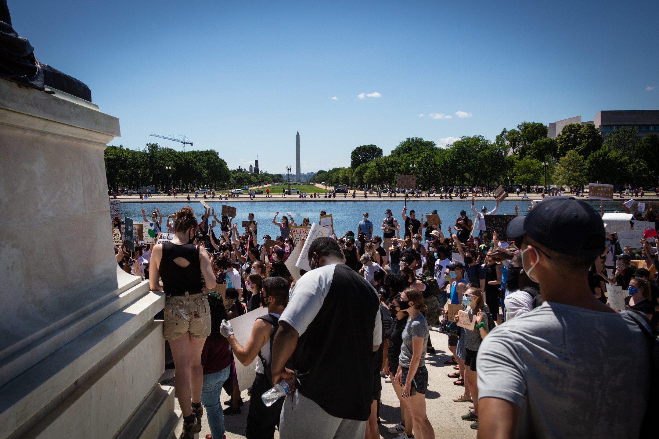 A crowd of protesters faces the Washington Monument from the steps of the United States Capitol in Washington, D.C., May 30, 2020.