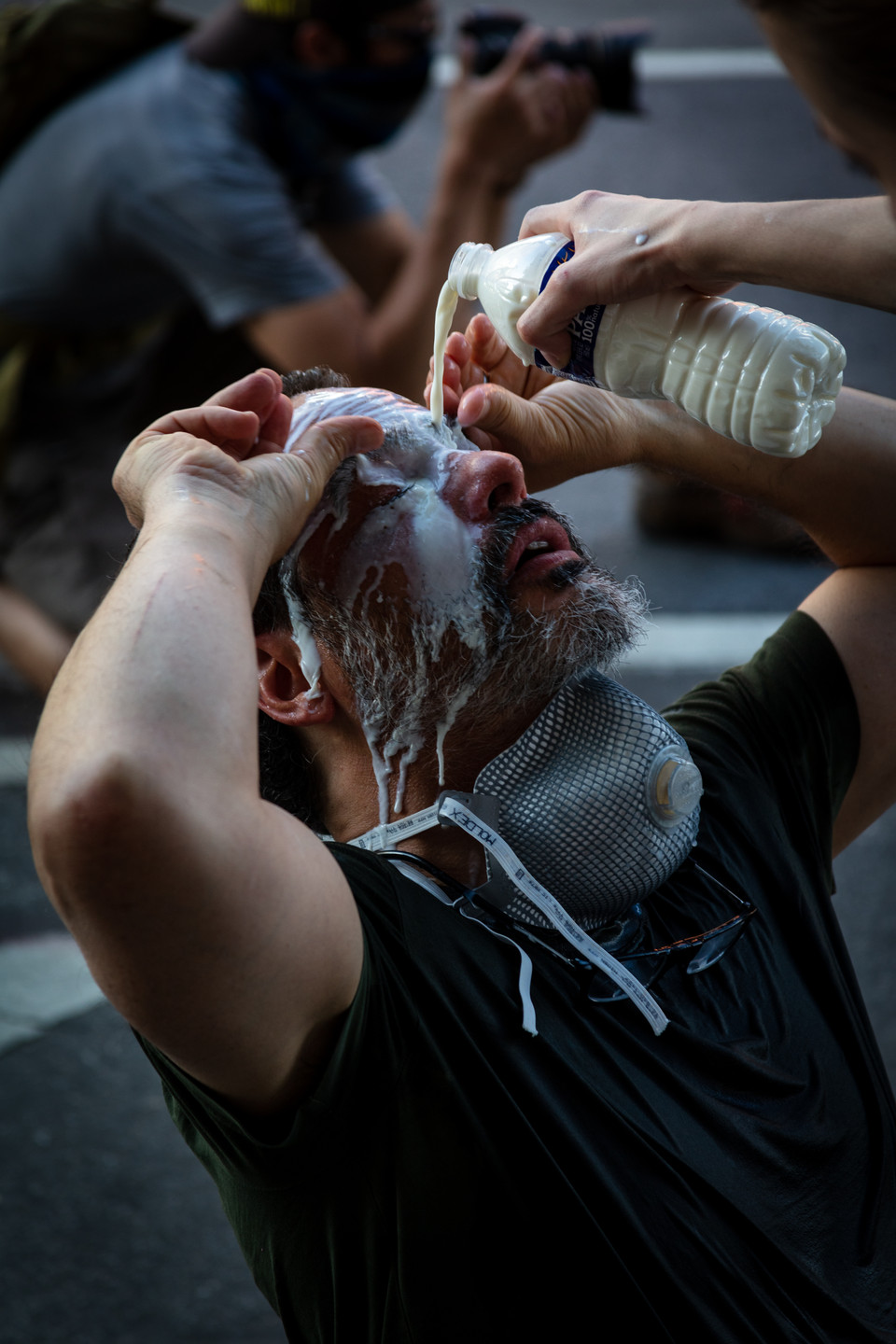 Jim Lo Scalzo, the 2016 White House News Photographers Association's photographer of the year, has milk poured on his eyes after being pepper-sprayed by police at protests outside of the White House in Washington, D.C., on May 30, 2020.