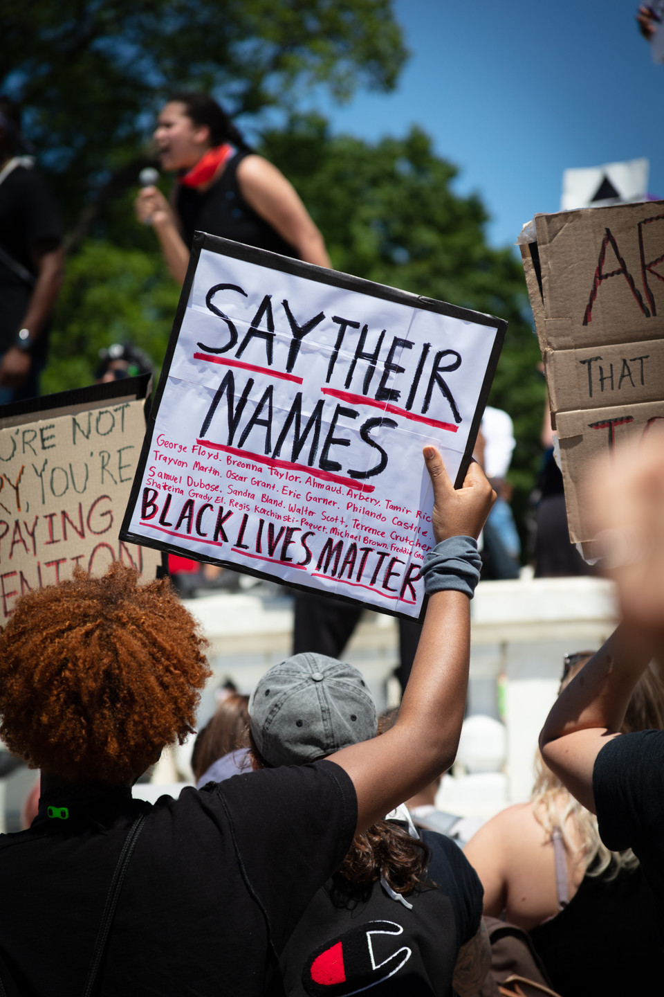 Protesters hold signs expressing their anger and frustration in front of the United States Capitol in Washington, D.C., May 30, 2020.