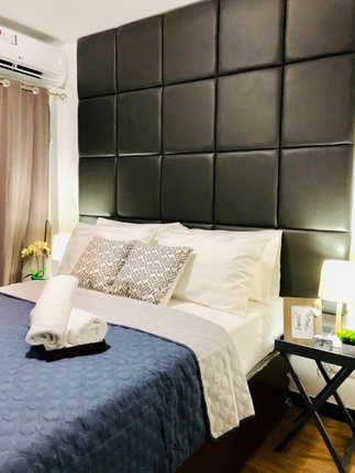 Master bed with our custom headboard