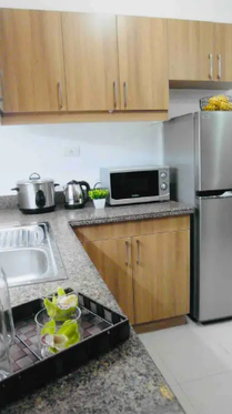 Kitchen features a full fridge,microwave, rice cooker and a hot water kettle