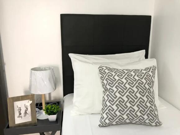 Single bed with custom headboard