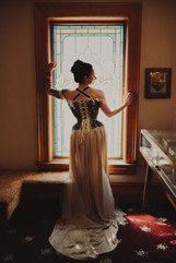 Real client, Dana, in her evening gown and demi-bust corset, both by Wild Rose Atelier.