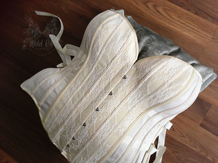 Plus size, fan-lacing overbust corset. Natural and champagne coutil with lace overlay.