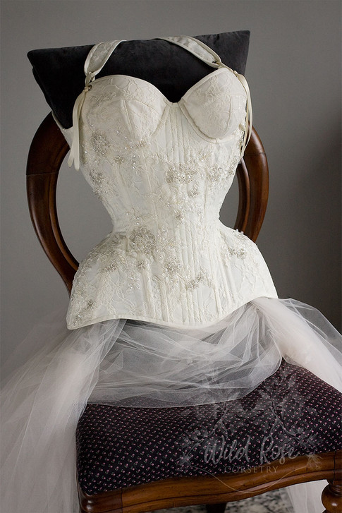 Cupped overbust, lace bridal corset with removable straps, lace applique and beading.