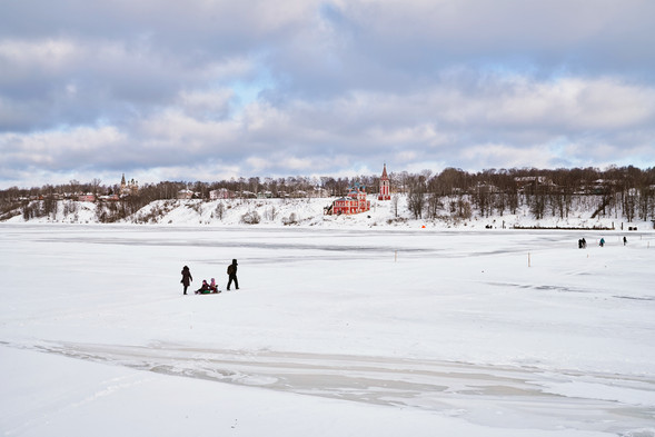 Family crossing frozen Volga River, Tutayev